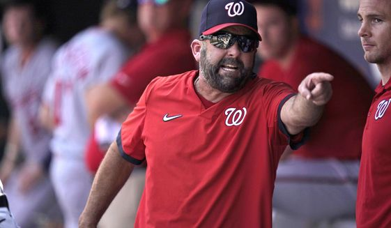 Washington Nationals hitting coach Kevin Long is ejected as he argues with an umpire during the fifth inning of a baseball game against the New York Mets at Citi Field, Thursday, Aug. 12, 2021, in New York. The Mets defeated the Nationals 4-1. (AP Photo/Seth Wenig) **FILE**
