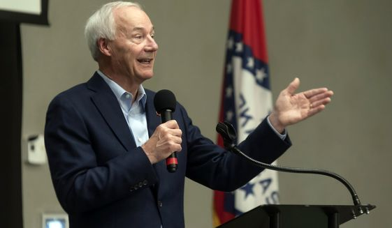 In this July 15, 2021, file photo, Arkansas Gov. Asa Hutchinson speaks during a town hall meeting in Texarkana, Ark. Hutchinson on Wednesday, Oct. 13, 2021, effectively approved a new U.S. House map that critics say weakens minority voters' influence in the state by splitting the Little Rock area among three congressional districts. (Kelsi Brinkmeyer/The Texarkana Gazette via AP, File)