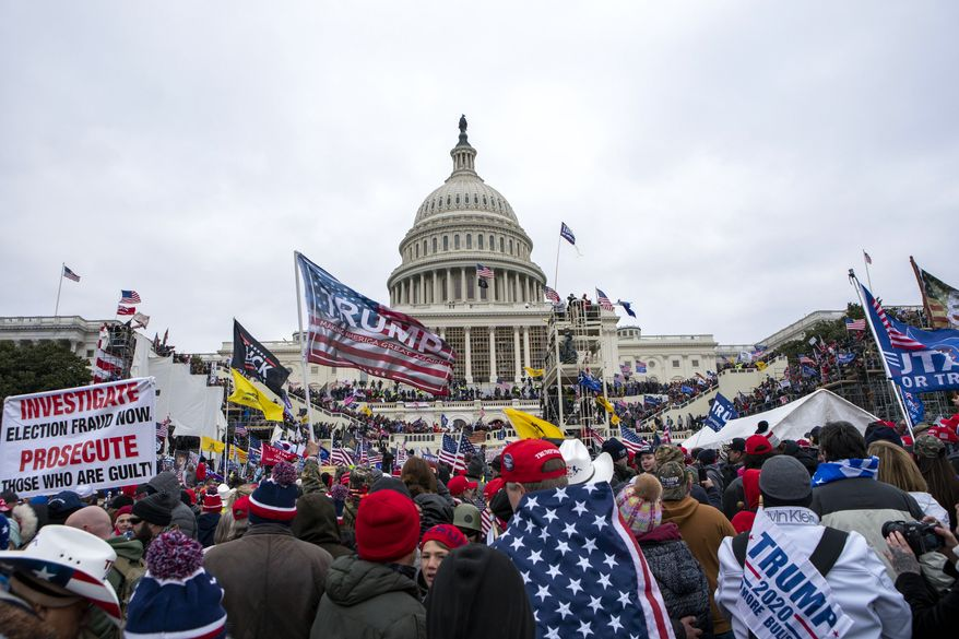 In this Jan. 6, 2021, photo, insurrections loyal to President Donald Trump rally at the U.S. Capitol in Washington. A federal judge held the director of the District of Columbia's Department of Corrections and the warden of the city's jail in contempt of court on Wednesday, Oct. 13, and asked the Justice Department to investigate whether the civil rights of inmates are being abused. U.S. District Judge Royce Lamberth had hauled the jail officials into court as part of the criminal case into Christopher Worrell, a member of the Proud Boys who has been charged in the Jan. 6 attack at the U.S. Capitol. (AP Photo/Jose Luis Magana) **FILE**