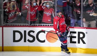Washington Capitals left wing Alex Ovechkin (8) celebrates his first goal of the third period in an NHL hockey game, Wednesday, Oct. 13, 2021, in Washington. The Capitals won 5-1. (AP Photo/Alex Brandon) **FILE**