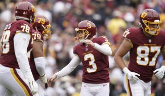 Washington Football Team kicker Dustin Hopkins (3) reacts after kicking a field goal against the New Orleans Saints in the first half of an NFL football game, Sunday, Oct. 10, 2021, in Landover, Md. (AP Photo/Julio Cortez)