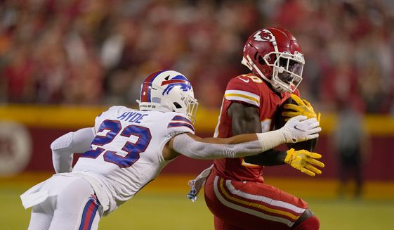 Kansas City Chiefs wide receiver Tyreek Hill, right, runs with the ball as Buffalo Bills safety Micah Hyde defends during the first half of an NFL football game Sunday, Oct. 10, 2021, in Kansas City, Mo. (AP Photo/Charlie Riedel) **FILE**