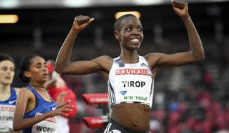 In this Thursday, May 30, 2019 file photo, Agnes Tirop of Kenya smiles after winning the women's 1500m race at the IAAF Diamond League meeting at Stockholm Olympic Stadium in Stockholm, Sweden. Kenyan runner Agnes Tirop, a two-time world championships bronze medalist, has been found dead at her home in Iten in western Kenya, the country's track federation said Wednesday, Oct. 13, 2021. (Fredrik Sandberg/TT News Agency via AP, File)