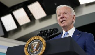 In this Oct. 8, 2021, file photo, President Joe Biden speaks about the September jobs report from the South Court Auditorium on the White House campus in Washington. During an epidemic of ransomware attacks, the U.S. is sitting down to talk cybersecurity strategy this week with 30 countries while leaving out one key player — Russia. The country that, unwittingly or not, hosts many of the criminal syndicates behind ransomware attacks around the world was not invited to a two-day meeting starting Wednesday. (AP Photo/Susan Walsh, File)