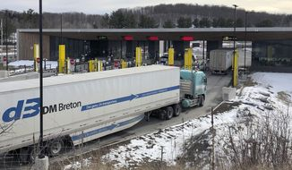 In this Wednesday, March 18, 2020, file photo, truck traffic from Canada waits to cross the border into the United States in Derby Line Vt. The U.S. will reopen its land borders to nonessential travel next month, ending a 19-month freeze due to the COVID-19 pandemic as the country moves to require all international visitors to be vaccinated against the coronavirus. The new rules, to be announced Wednesday, Oct. 13, 2021, will allow fully vaccinated foreign nationals to enter the U.S. regardless of the reason for travel (AP Photo/Wilson Ring, File)