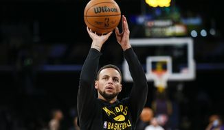 Golden State Warriors guard Stephen Curry warms up before a preseason NBA basketball game against the Los Angeles Lakers in Los Angeles, Tuesday, Oct. 12, 2021. (AP Photo/Ringo H.W. Chiu) **FILE**