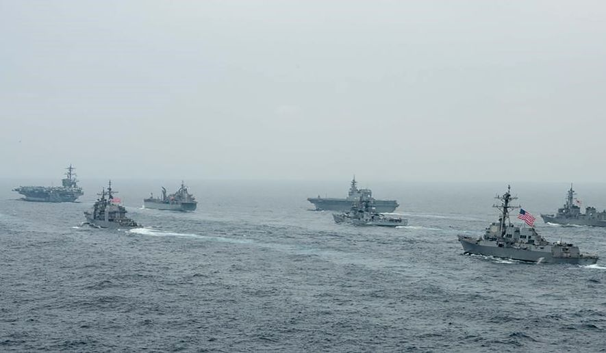 In this photo released by U.S. Navy, U.S. Navy aircraft carrier USS Carl Vinson (CVN 70) and other U.S. and allies' vessels transit the Bay of Bengal as part of MALABAR 2021, on Oct. 12, 2021. China seeks to bring the strategically and symbolically important island back under its control, and the U.S. sees Taiwan in the context of broader challenges from China. (Russel Lindsey/US Navy via AP)