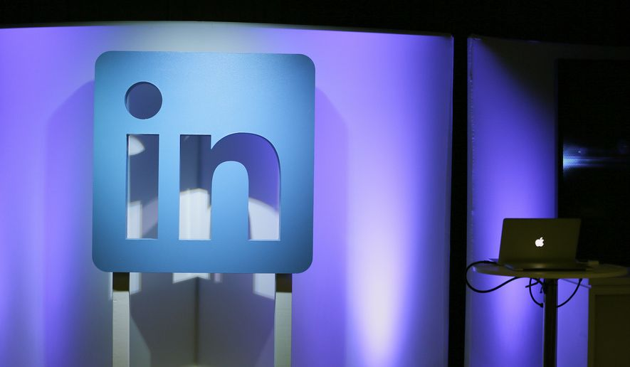 """In this Thursday, Sept. 22, 2016, photo, the LinkedIn logo is displayed during a product announcement in San Francisco. """" (AP Photo/Eric Risberg) **FILE**"""