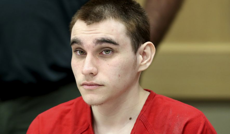 FILE - In this Dec. 10, 2019, file photo, Parkland school shooting defendant Nikolas Cruz appears at a hearing in Fort Lauderdale, Fla. A court hearing is set Friday, Oct. 15, 2021 in Florida for Nikolas Cruz, the man police said has confessed to the 2018 massacre of 17 people at a high school. The hearing in Broward County Circuit Court was scheduled abruptly Thursday and does not describe the purpose.(Amy Beth Bennett/South Florida Sun Sentinel via AP, Pool, File)