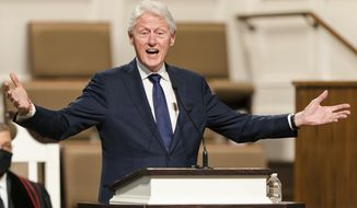 """In this Jan. 27, 2021, file photo, former President Bill Clinton speaks during funeral services for Henry """"Hank"""" Aaron, at Friendship Baptist Church in Atlanta. (Kevin D. Liles/Atlanta Braves via AP, Pool, File)"""