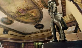 In this July 14, 2010, photo, a statue of Thomas Jefferson, right, stands in New York's City Hall Council Chamber. The 1833 statue will be taken out of New York's City Hall in the coming days and sent to the New-York Historical Society as a long-term loan, capping longstanding efforts to remove the founding father's likeness because he owned slaves. (AP Photo/Richard Drew) **FILE**