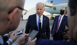 President Joe Biden speaks to members of the media before boarding Air Force One at Bradley International Airport, Friday, Oct. 15, 2021, in Windsor Locks, Conn. (AP Photo/Evan Vucci)