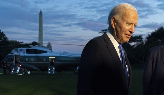 President Joe Biden speaks to reporters on the South Lawn upon arrival at the White House in Washington, Friday, Oct. 15, 2021. (AP Photo/Manuel Balce Ceneta)