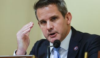 In this July 27, 2021, file photo, Rep. Adam Kinzinger, R-Ill., speaks on Capitol Hill in Washington. Illinois Democrats are poised to approve new congressional district maps that would give Democratic candidates an advantage in elections over the next decade and eliminate at least one GOP-held district as the party fights to keep control of the U.S. House in 2022.Democrats who control state government releasedtheir proposed mapsFriday, Oct. 15, 2021. (Jim Bourg/Pool via AP)