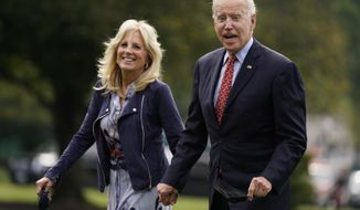 In this Oct. 4, 2021, photo, President Joe Biden and first lady Jill Biden arrive on the South Lawn of the White House after spending the weekend in Wilmington, Del., in Washington. (AP Photo/Evan Vucci)