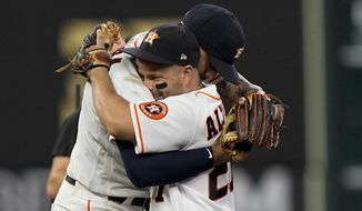 Houston Astros shortstop Carlos Correa celebrates their win with Jose Altuve against the Boston Red Sox in Game 1 of baseball's American League Championship Series Friday, Oct. 15, 2021, in Houston. (AP Photo/David J. Phillip) **FILE**
