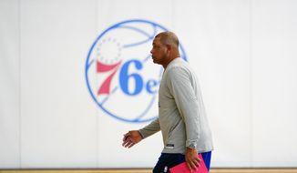 Philadelphia 76ers' Doc Rivers walks the court after practice at the NBA basketball team's facility, Sunday, Oct. 17, 2021, in Camden, N.J. (AP Photo/Matt Slocum)