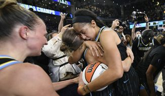 Chicago Sky's Candace Parker, center right, and Allie Quigley, center left, celebrate after defeating the Phoenix Mercury 80-74 in Game 4 of the WNBA Finals to win the championship, Sunday, Oct. 17, 2021, in Chicago. (AP Photo/Paul Beaty)