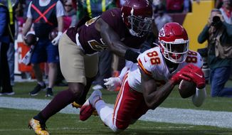 Kansas City Chiefs tight end Jody Fortson (88) makes a catch against Washington Football Team safety Landon Collins (26) during the first half of an NFL football game, Sunday, Oct. 17, 2021, in Landover, Md. (AP Photo/Alex Brandon)