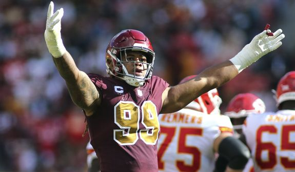 Washington Football Team defensive end Chase Young (99) celebrates during an NFL football game against the Kansas City Chiefs, Sunday, Oct. 17, 2021 in Landover, Md. (AP Photo/Daniel Kucin Jr.)