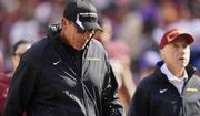 Washington Football Team head coach Ron Rivera spits as he walks off field at the end of the first half of an NFL football game against the Kansas City Chiefs, Sunday, Oct. 17, 2021, in Landover, Md. (AP Photo/Patrick Semansky)