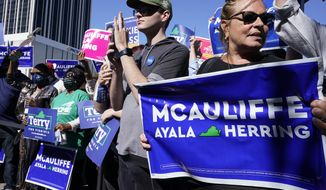 Supporters of Democratic gubernatorial candidate, former Virginia Gov. Terry McAuliffe, cheer their candidate during a rally in Norfolk, Va., Sunday, Oct. 17, 2021. (AP Photo/Steve Helber)