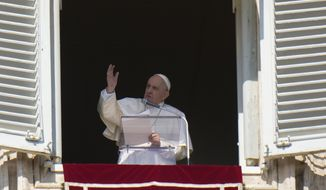 Pope Francis blesses faithful during the Angelus noon prayer he delivers from the window of his studio overlooking St. Peter's Square at the Vatican, Sunday, Oct. 17, 2021. (AP Photo/Alessandra Tarantino)