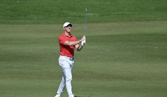 Rory McIlroy, of Northern Ireland, watches his second shot on the first hole during final round of the CJ Cup golf tournament, Sunday, Oct. 17, 2021, in Las Vegas. (AP Photo/David Becker)