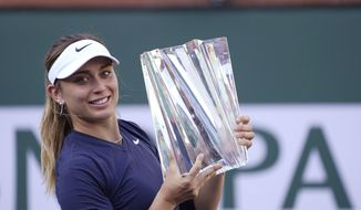 Paula Badosa, of Spain, holds up her trophy after defeating Victoria Azarenka, of Belarus, in the singles final at the BNP Paribas Open tennis tournament Sunday, Oct. 17, 2021, in Indian Wells, Calif. (AP Photo/Mark J. Terrill)