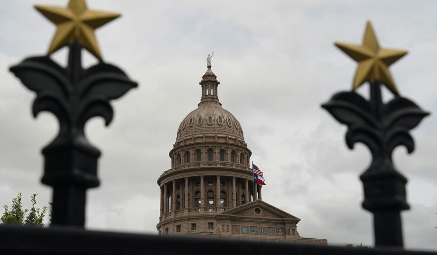 This June 1, 2021, file photo shows the State Capitol in Austin, Texas. Texas Republicans approved on Monday, Oct. 18, redrawn U.S. House maps that favor incumbents and decrease political representation for growing minority communities, even as Latinos drive much of the growth in the nation's largest red state. (AP Photo/Eric Gay, File)