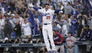 Los Angeles Dodgers center fielder Cody Bellinger reacts after hitting a three-run home run during the eighth inning in Game 3 of baseball's National League Championship Series against the Atlanta Braves Tuesday, Oct. 19, 2021, in Los Angeles. (AP Photo/Jae Hong)