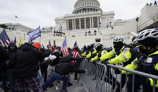 In this Jan. 6, 2021, file photo, Trump supporters try to break through a police barrier at the U.S. Capitol in Washington. A House committee tasked with investigating the Jan. 6 Capitol insurrection is moving swiftly to hold at least one of Donald Trumps allies, former White House aide Steve Bannon, in contempt. That's happening as the former president is pushing back on the probe in a new lawsuit. (AP Photo/Julio Cortez)