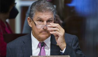 Sen. Joe Manchin, D-W.Va., a key holdout vote on President Joe Biden's domestic agenda, chairs a hearing of the Senate Energy and Natural Resources Committee, at the Capitol in Washington, Tuesday, Oct. 19, 2021. (AP Photo/J. Scott Applewhite) **FILE**