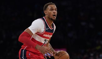 Washington Wizards center Daniel Gafford (21) dribbles in the first half during NBA game against the New York Knicks, Friday Oct. 15, 2021, in New York. (AP Photo/Mary Altaffer) **FILE**