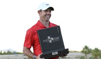 Rory McIlroy, of Northern Ireland, displays the trophy after winning the CJ Cup golf tournament, Sunday, Oct. 17, 2021, in Las Vegas. (AP Photo/David Becker) **FILE**
