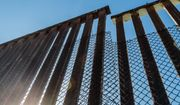 A section of the border fence separating San Diego, California and Tijuana, Mexico. Photo credit: Sherry V. Smith via Shutterstock