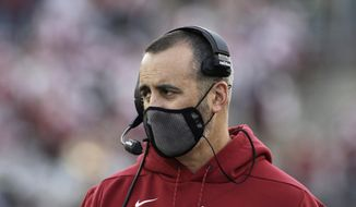 In this Saturday, Oct. 16, 2021, file photo, Washington State coach Nick Rolovich watches during the first half of an NCAA college football game against Stanford in Pullman, Wash. The NHL suspending San Jose's Evander Kane 21 games for submitting a fake vaccination card and Washington State firing football coach Nick Rolovich for failing to comply with a vaccine mandate Monday provided two more reminders of the impact the coronavirus is still having on professional and college sports. (AP Photo/Young Kwak, File) **FILE**