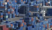 A trailer truck drives amid stacked containers at Port Miami, Wednesday, Oct. 20, 2021, in Miami. The Federal Reserve reports that the economy faced a number of headwinds at the start of this month, ranging from supply-chain disruptions and labor shortages to uncertainty about the delta variant of COVID-19. (AP Photo/Rebecca Blackwell)