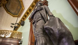 A statue of Thomas Jefferson holding the Declaration of Independence stands in New York's City Hall Council Chamber on Wednesday, October 20, 2021. The 1833 statue of Jefferson will be removed from the council chamber by the end of the year. Some New York City Council members have called for years to remove the statue from the room where they conduct business because Jefferson was a slaveholder. (AP Photo/Ted Shaffrey)