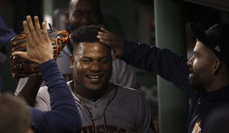 Houston Astros starting pitcher Framber Valdez celebrates in the dugout after the eighth inning in Game 5 of baseball's American League Championship Series against the Boston Red Sox Wednesday, Oct. 20, 2021, in Boston. (AP Photo/Winslow Townson)