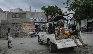 Security forces patrol the streets of Croix-des-Bouquets, near Port-au-Prince, Haiti, Tuesday, Oct. 19, 2021. A general strike continues in Haiti demanding that authorities address the nation's lack of security, four days after 17 members of a U.S.-based missionary group were abducted by a gang. (AP Photo/Matias Delacroix)