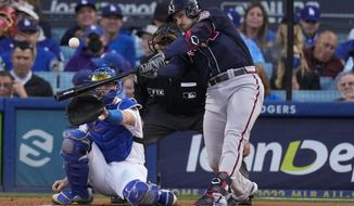 Atlanta Braves' Adam Duvall celebrates his solo home run in the second inning against the Los Angeles Dodgers in Game 4 of baseball's National League Championship Series Wednesday, Oct. 20, 2021, in Los Angeles. (AP Photo/Marcio Jose Sanchez)