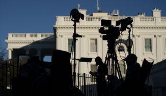 Media organizations set up outside the White House. (AP Photo/Evan Vucci)