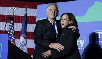 Vice President Kamala Harris, right, shares a hug with Democratic gubernatorial candidate, former Virginia Gov. Terry McAuliffe during a rally in Dumfries, Va., Thursday, Oct. 21, 2021. McAuliffe will face Republican Glenn Youngkin in the November election. (AP Photo/Steve Helber)