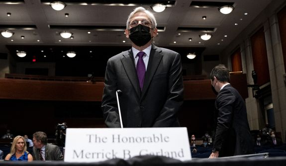 Attorney General Merrick Garland arrives to testify during a House Judiciary Committee oversight hearing of the Department of Justice on Thursday, Oct. 21, 2021, on Capitol Hill in Washington. (Greg Nash/Pool via AP)