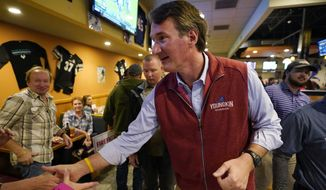 Virginia Republican gubernatorial candidate Glenn Youngkin greets supporters during a meet and greet at a sports bar in Chesapeake, Va., Monday, Oct. 11, 2021. Youngkin faces former Governor Terry McAuliffe in the November election. (AP Photo/Steve Helber)