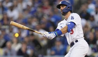 Los Angeles Dodgers' Chris Taylor watches his two-run home run in the second inning against the Atlanta Braves in Game 5 of baseball's National League Championship Series Thursday, Oct. 21, 2021, in Los Angeles. Pujols scored on the hit. (AP Photo/Jae C. Hong)