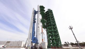 In this photo provided by Korea Aerospace Research Institute via Yonhap, the Nuri rocket, the first domestically produced space rocket, sits on its launch pad at the Naro Space Center in Goheung, South Korea, Wednesday, Oct. 20, 2021. South Korea was preparing to test-launch its first domestically produced space rocket Thursday, Oct.21, in what officials describe as an important step in its pursuit of a satellite launch program. (Korea Aerospace Research Institute/Yonhap via AP)