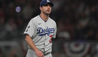 Los Angeles Dodgers starting pitcher Max Scherzer walks off the field after being relieved in the fifth inning in Game 2 of baseball's National League Championship Series against the Atlanta Braves Sunday, Oct. 17, 2021, in Atlanta. (AP Photo/Brynn Anderson)