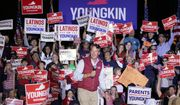Republican gubernatorial candidate Glenn Youngkin reacts to the crowd during a rally in Glen Allen, Va., Saturday, Oct. 23, 2021. Youngkin will face Democrat Terry McAuliffe in the November election. (AP Photo/Steve Helber)